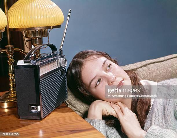 1960s TEENAGE GIRL LYING...