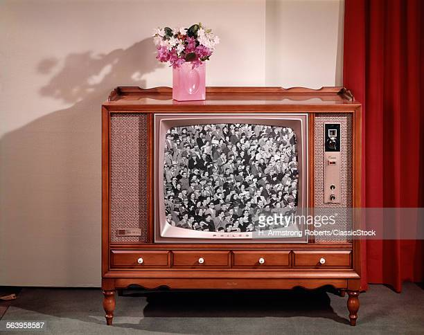 1960s TELEVISON SHOWING CROWD OF PEOPLE