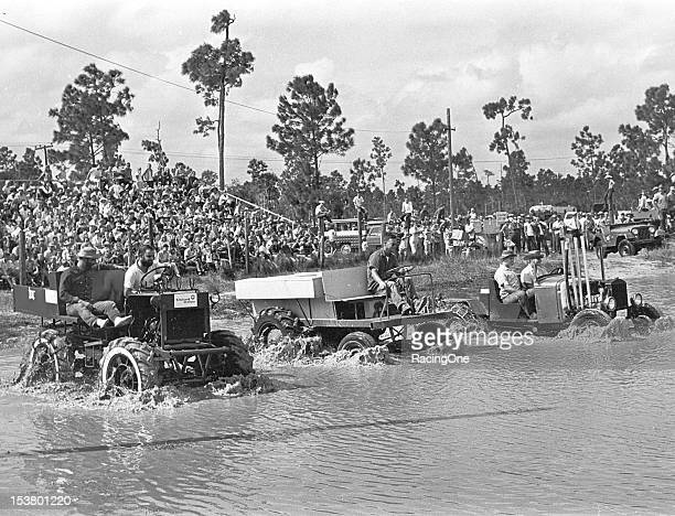 "Three competing teams start a race aboard their homemade Swamp Buggies on the 7/8mile long ""Mile O' Mud"" at Florida Sports Park The facility grew..."