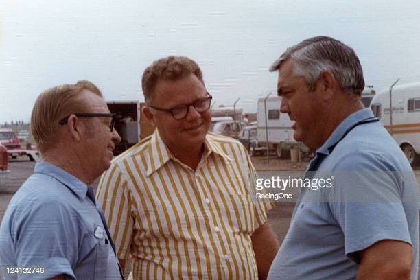 Three of the top car owners of all time in NASCAR Cup racing confer at an event in the late 1960s Cotton Owens Banjo Matthews and Junior Johnson...