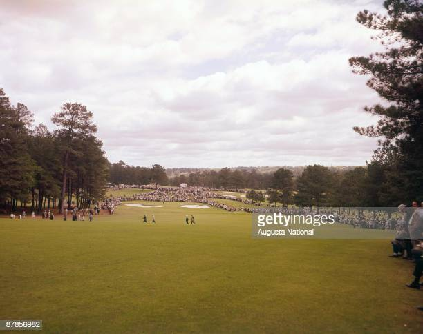 Tournament play on the second hole during a 1960s Masters Tournament at Augusta National Golf Club in Augusta Georgia