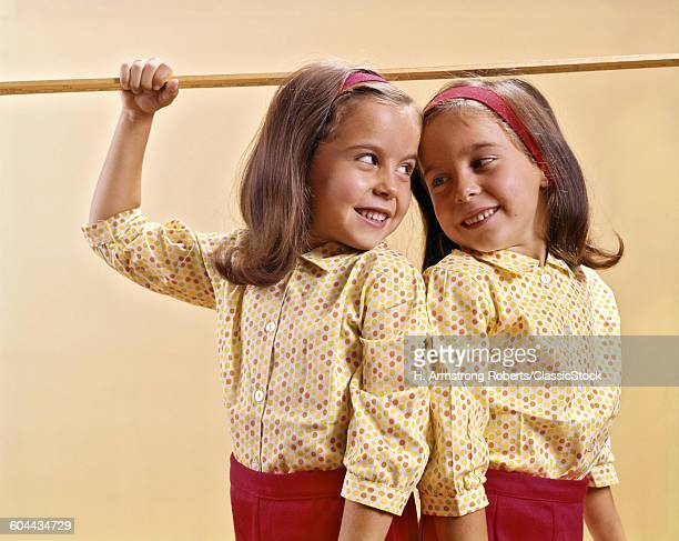 1960s TWIN GIRLS MEASURING.