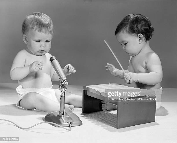 1960s TWO BABIES IN...