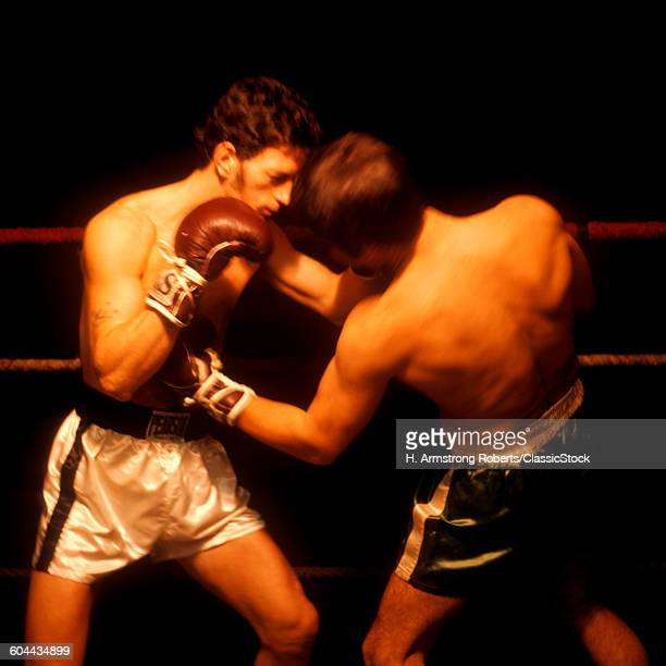 1960s TWO MEN BOXING ONE.