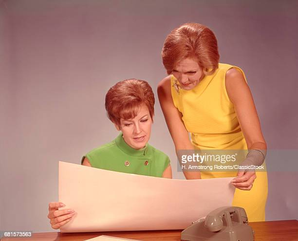 1960s TWO WOMEN EXECUTIVES...