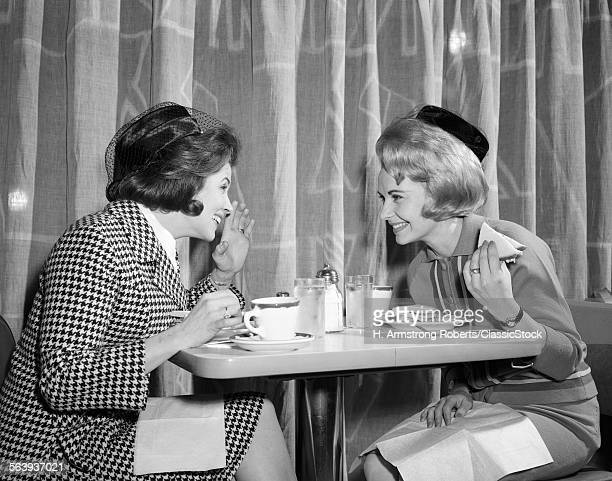 1960s TWO WOMEN GOSSIPING...
