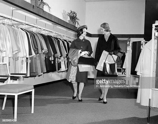 1960s TWO WOMEN SHOPPING...