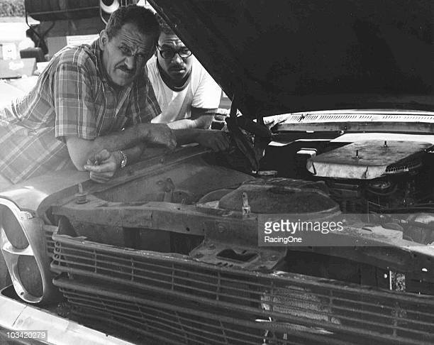 Wendell Scott checks over the engine of his 1966 NASCAR Cup Ford at a race in the mid-Ô60s.