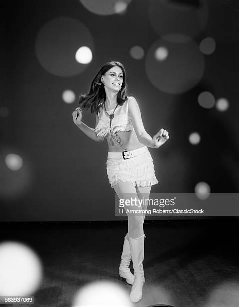1960s WOMAN DANCING IN...