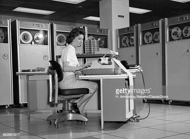 1960s WOMAN IN MAINFRAME...