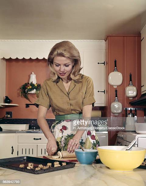 1960s WOMAN KITCHEN BAKING...