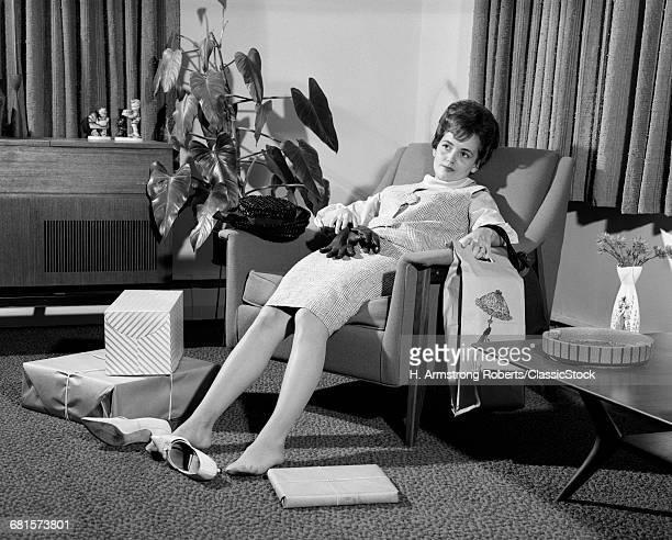 1960s WOMAN PLOPPED DOWN...