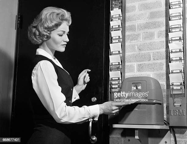 1960s WOMAN PUNCHING TIME...