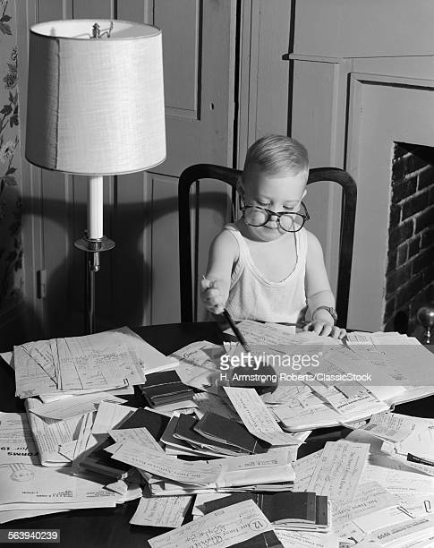 1960s YOUNG BOY AT DESK...