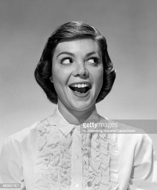 1960s YOUNG WOMAN GIRL LAUGHING LOOKING TO THE LEFT