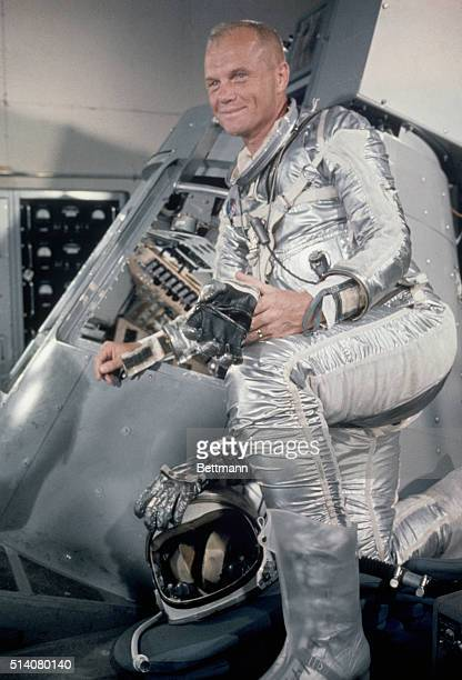 Cape Canaveral FLORIGINAL CAPTION READS Lt Col John Glenn standing beside a Mercury capsule