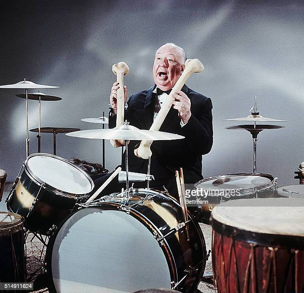 1965Hollywood California Alfred Hitchcock motion picture and television producer/director He is standing near drum set while holding gigantic bones