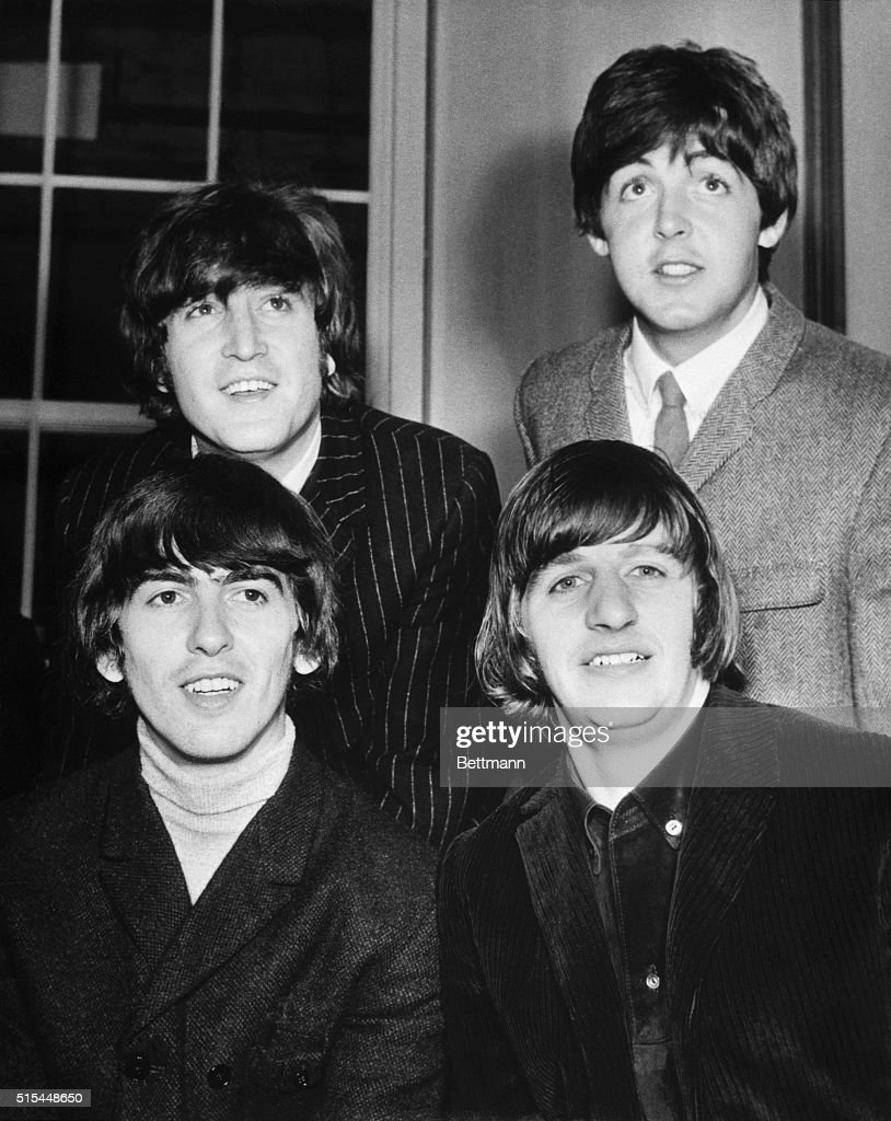 Twickenham, Middlesex, England- The Beatles, the British singing group, are all smiles after they were elevated to Queen Elizabeth's honors list as members of the Order of the British Empire June 12. Britons reacted with laughter, astonishment and outright anger to the youngsters' appointment and even the Beatles themselves were amazed. Left to right (foreground): George Harrison and Ringo Starr. In the rear (left to right) are John Lennon and Paul McCartney.