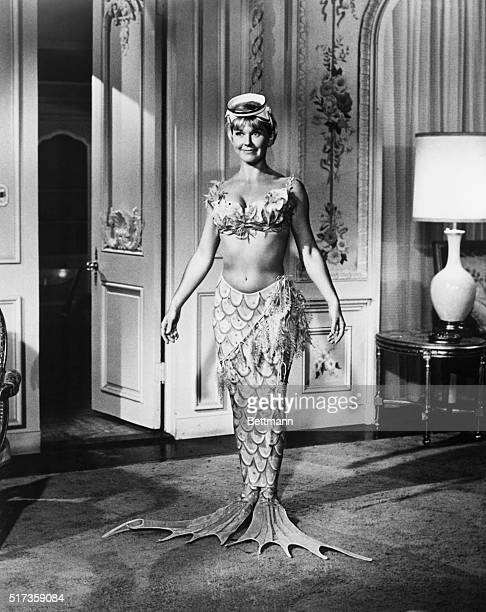 1966Jennifer Nelson presents a glamorous picture as she tries on the mermaid outfit she will wear while swimming under her father's glassbottom boat...