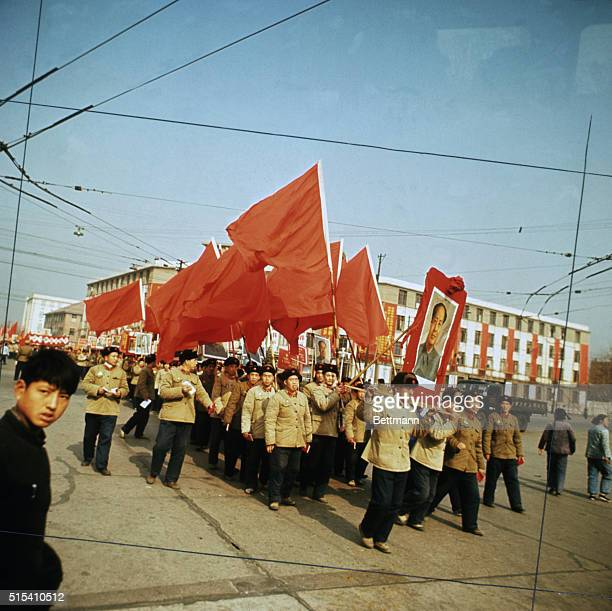Red guards parade through street carrying a portrait of Mao TseTung and red flags BPA2