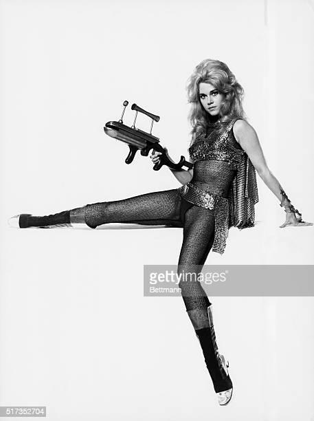 1968Publicity handout for the film Barbarella with Jane Fonda in a metallic bikini and cape holding a ray gun
