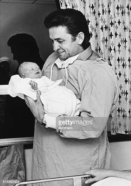 1970Country music singer Johnny Cash is shown holding his newborn son John
