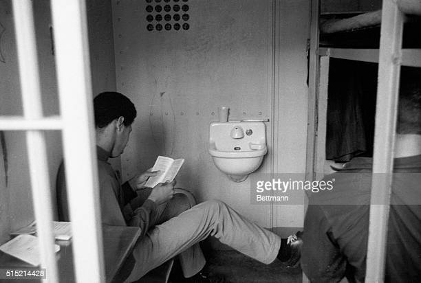 1970Rikers Island New York Prisoner reading a book sits in his cell at Rikers Island Prison