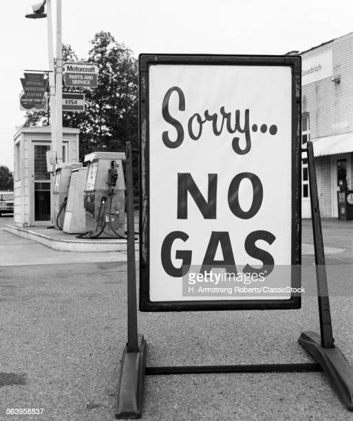 1970s 1973 SORRY NO GAS SIGN BESIDE GAS PUMPS AT SERVICE STATION DUE TO OPEC OIL CRISIS