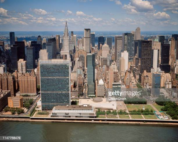 1970s 1979 AERIAL VIEW MIDTOWN MANHATTAN SKYLINE FROM EAST RIVER LOOKING WEST UNITED NATIONS AND CHRYSLER BUILDINGS