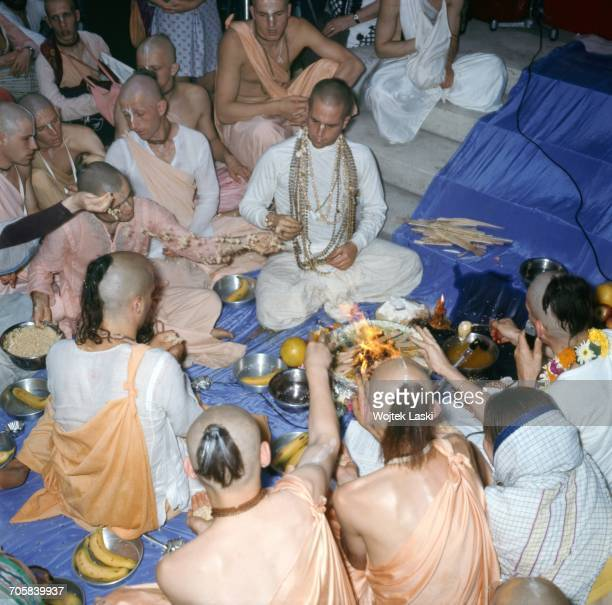 A meeting of followers of the hare krishna religious organisation a section of hinduism Pictured members of the International Society for Krishna...