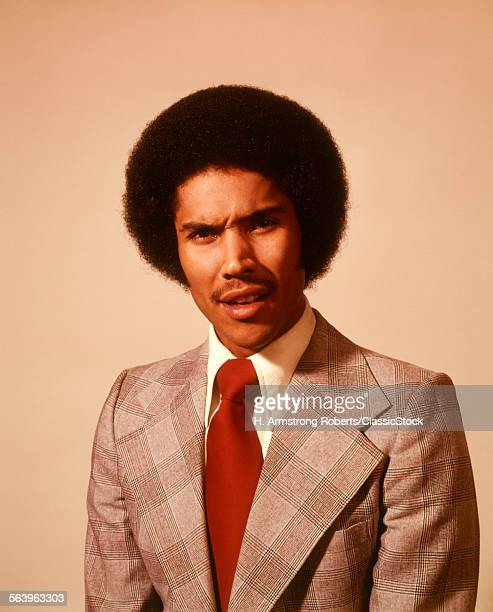 1970 1970s AFRICAN AMERICAN YOUNG MAN SERIOUS WORRIED WORRY ANXIOUS ANGRY FACIAL EXPRESSION AFRO HAIRDO HAIR DO