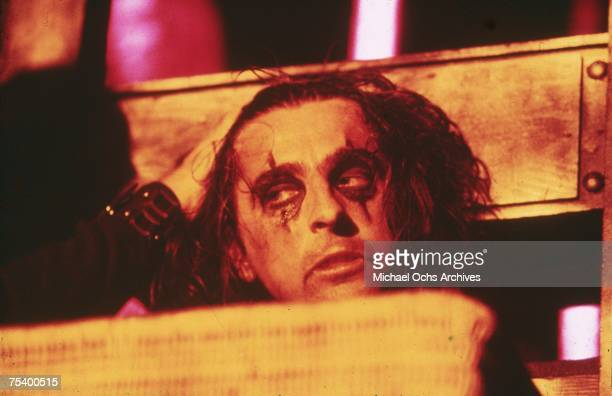 Alice Cooper with his head in a guillotine for his outrageous stage show in the mid 1970's
