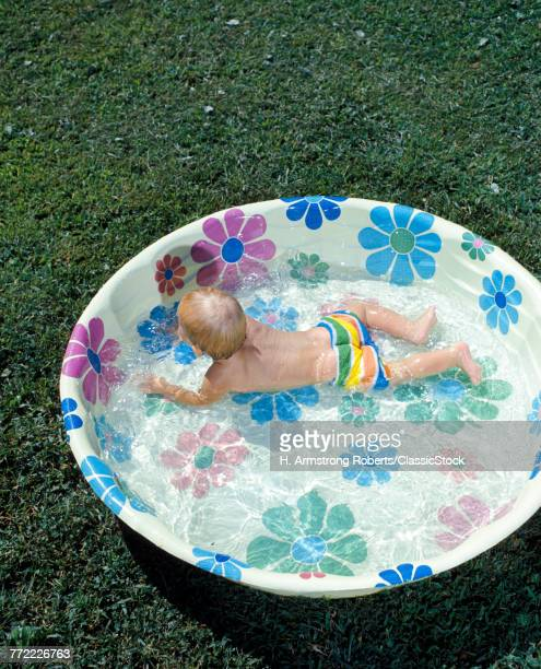 1970s BABY PLAYING...
