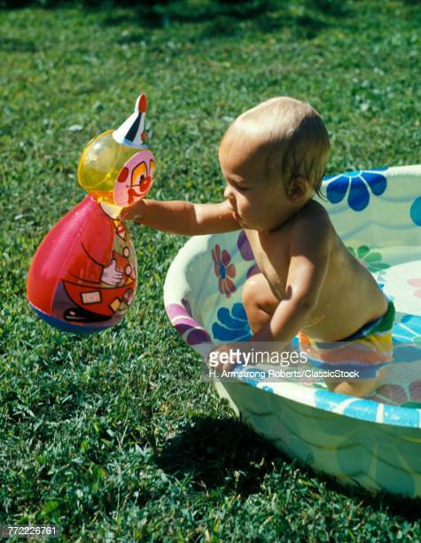 1970s BABY PLAYING WITH...