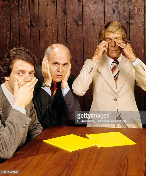 1970s BUSINESSMEN AS THREE...