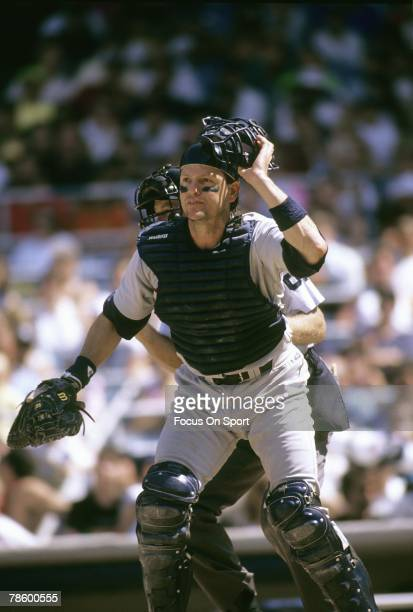 Catcher Carlton Fisk of the Boston Red Sox stands at home plate waiting on the throw during a MLB baseball game circa mid 1970s Fisk played for the...