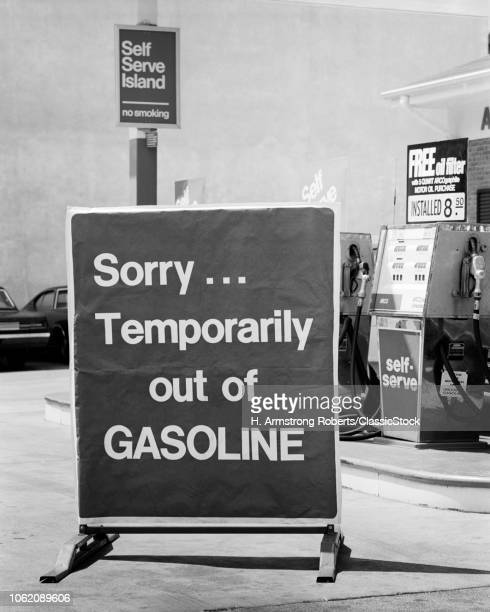 1970s CLOSE-UP SORRY TEMPORARILY OUT OF GASOLINE SIGN AT SELF SERVICE GAS STATION DURING 1973 OPEC OIL SHORTAGE CRISIS
