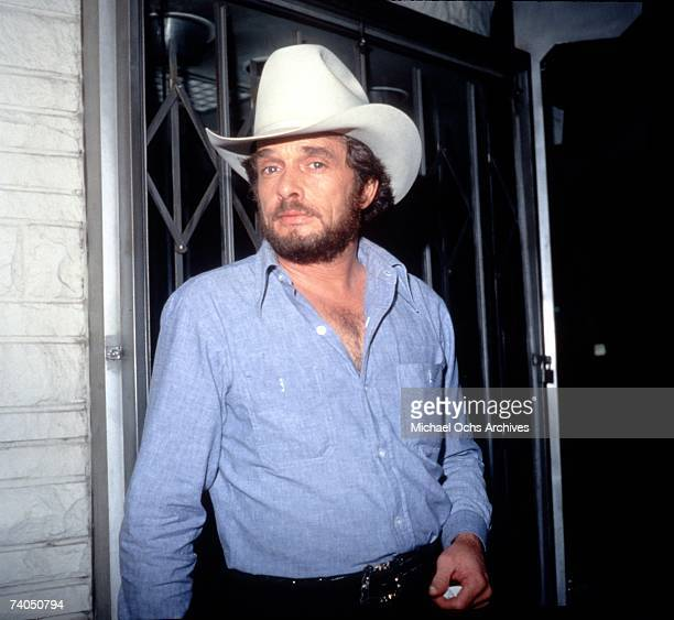 Country musician Merle Haggard backstage during a circa late 1970's taping of the Merv Griffin Show in Los Angeles California