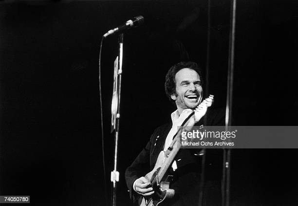 Country musician Merle Haggard performs on stage during a mid 1970's concert