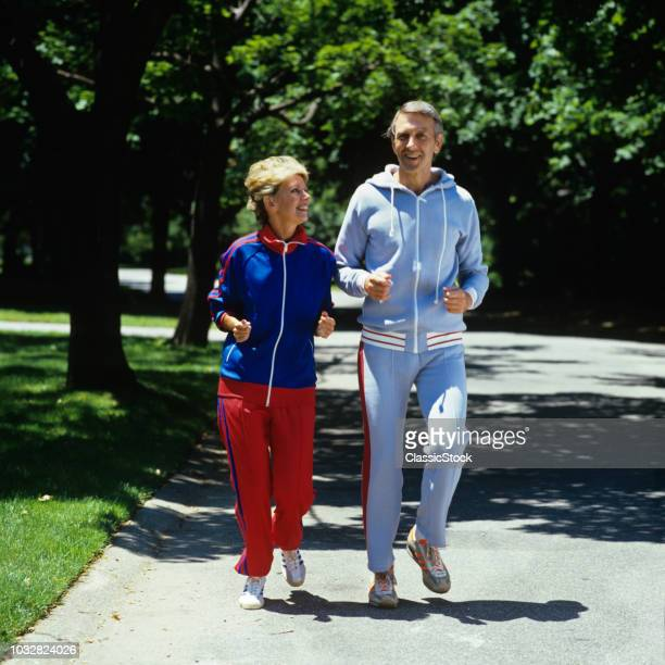 1970s COUPLE MAN AND WOMAN JOGGING TOGETHER