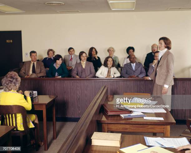 1970s COURT ROOM SCENE WOMAN PROSECUTION ATTORNEY ADDRESSING JURY