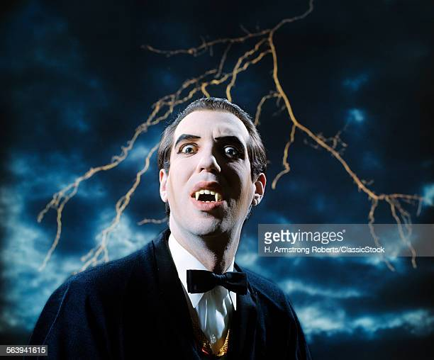 1970s DRACULA VAMPIRE CHARACTER LOOKING AT CAMERA WITH LIGHTNING IN STORMY SKY