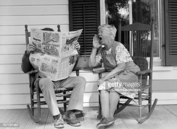 1970s ELDERLY COUPLE IN...