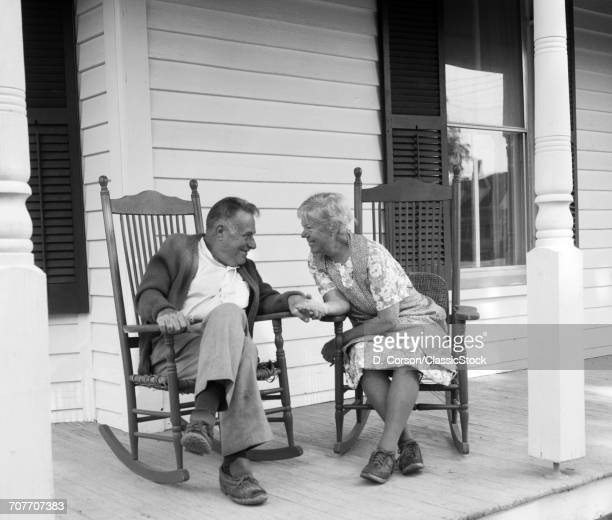 1970s ELDERLY COUPLE IN...