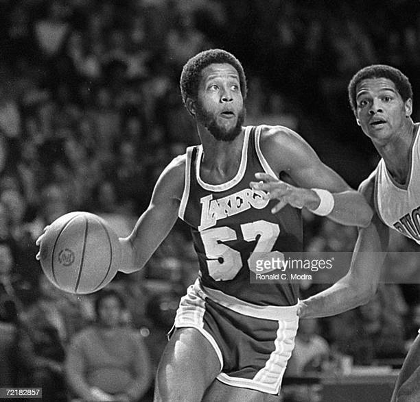 Jamaal Wiles of the Los Angeles Lakers dribbles the ball in a game against the Milwaukee Bucks in the 1970s in Milwaukee Wisconsin