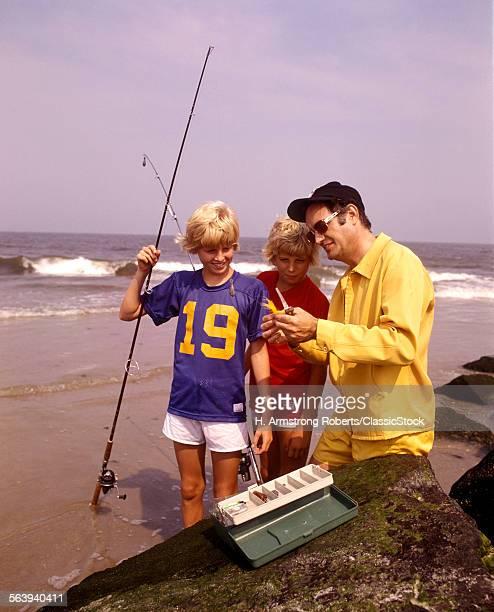 1970s MAN FATHER TEACHING...