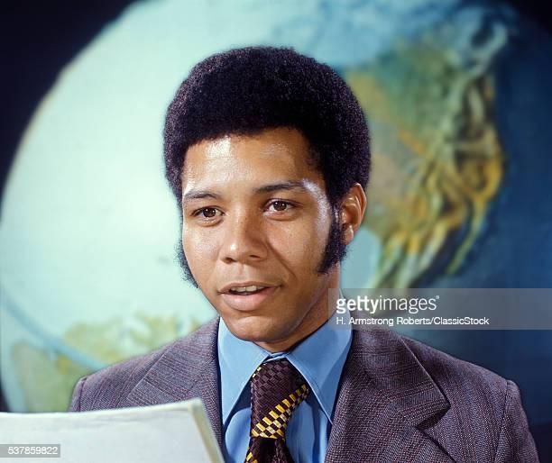 1970s MAN NEWSCASTER...