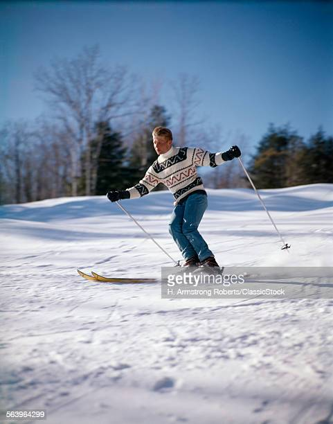 1970s MAN SKIING DOWN HILL