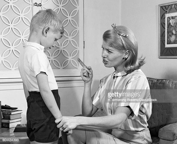 1970s MOTHER DISCIPLINING HER SON BY TALKING HARSHLY AND SHAKING HER FINGER BOY HANGING HIS HEAD IN SHAME