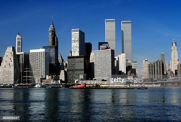 1970s NEW YORK CITY NY SKYLINE DOWNTOWN FROM HARBOR
